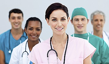 Female PEMF Doctor standing in Front of her team
